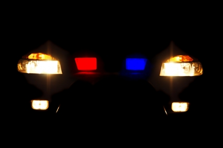 police equipment: bright headlights of police car at night Stock Photo