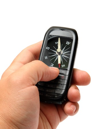 mobile phone in man hand with compass on screen Stock Photo - 7506787