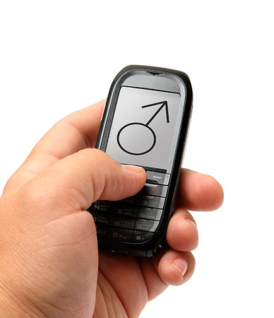 mobile phone in man hand with male sign Stock Photo - 7619705