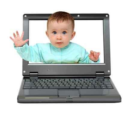 small laptop with cute baby on screen photo