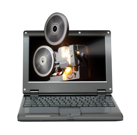 small laptop with old projector showing film photo