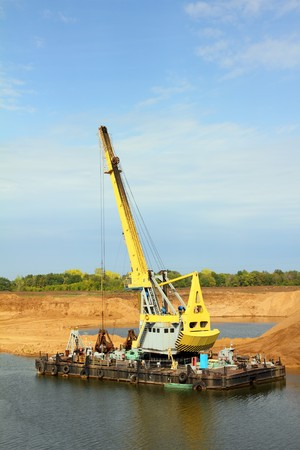 floating excavator - development sandpit with dredge photo