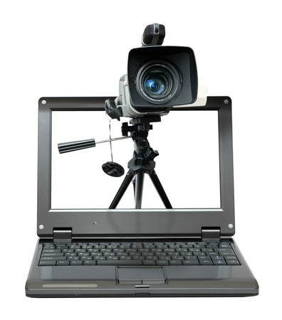 small laptop with video camera on tripod