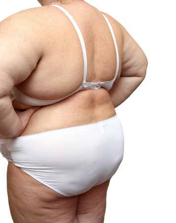 abstinence: overweight woman body in underwear isolated on white