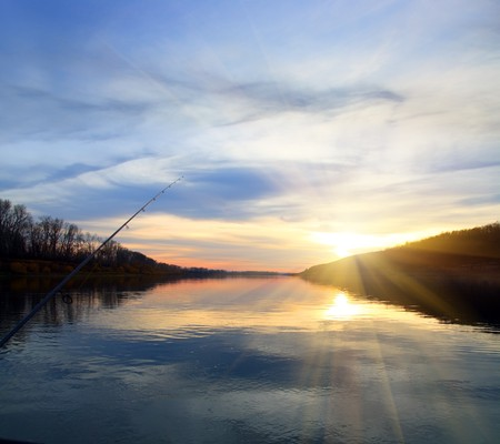 fishing on evening river with sunset - landscape Stock Photo - 8011715