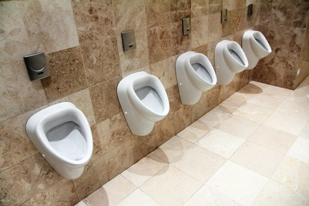 piddle: row of urinals in empty clean restroom Stock Photo