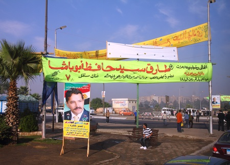 exotics: CAIRO, EGYPT - NOVEMBER 21, 2010: Campaign posters on the streets of Cairo Editorial
