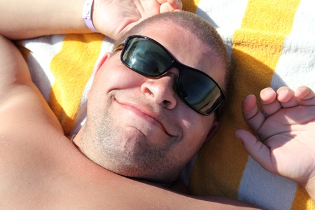 funny tourist face in sunglasses - relax on beach photo