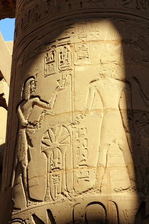 column in karnak temple with ancient egypt images and hieroglyphics photo