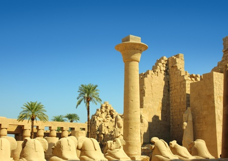 column and statues of sphinx in famouse karnak temple - luxor Stock Photo - 9180184