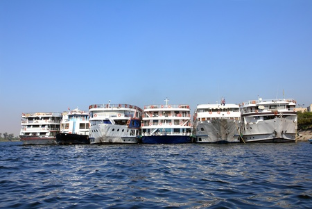 old passenger ships standing in port on Nile photo