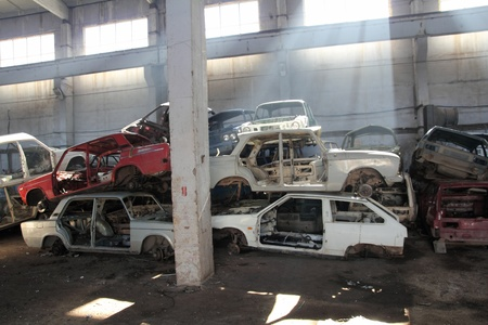heap of cars is returned for recycling as scrap metal photo