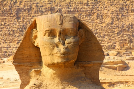famous ancient egypt sphinx face and pyramid in Giza photo