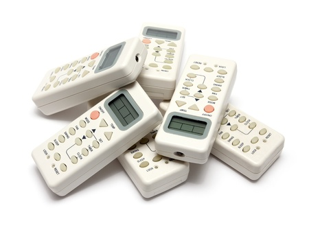 remote infrared devices in heap isolated on white photo