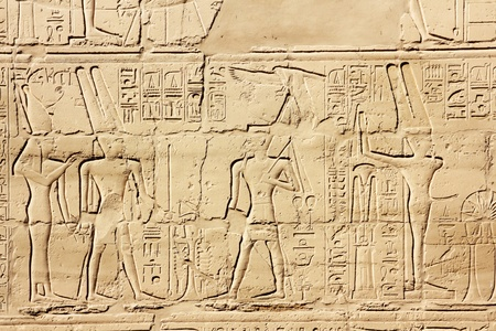 ancient egypt images and hieroglyphics on wall in karnak temple photo