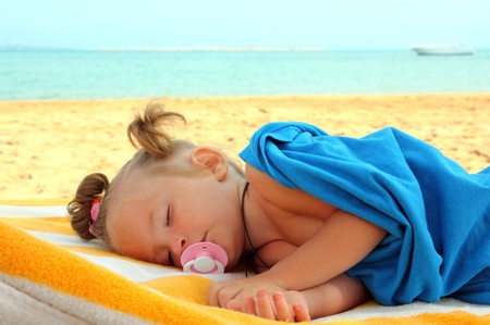 little girl sleeping on beach near sea Stock Photo - 9656018