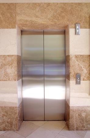 empty contemporary interior with elevator steel doors