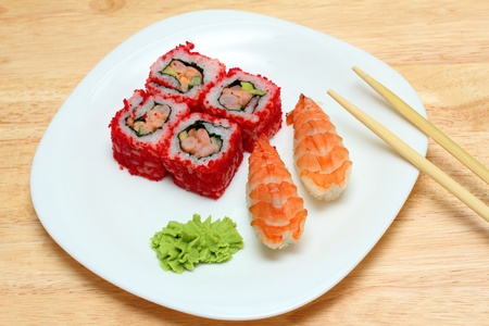 Japanese cuisine - rolls and sushi on plate photo