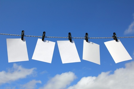 blank photos are hanging against blue sky Stock Photo - 10627658