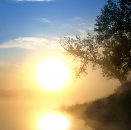 landscape with beautiful fog sunrise on river photo