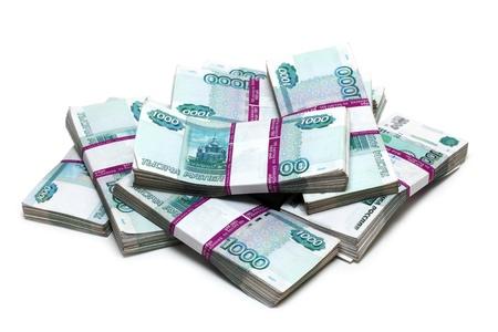 million: million rubles - heap of bills in packs of Russian Stock Photo