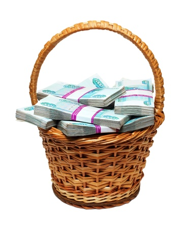 roubles: overflowing basket with money - millions of russian roubles Stock Photo