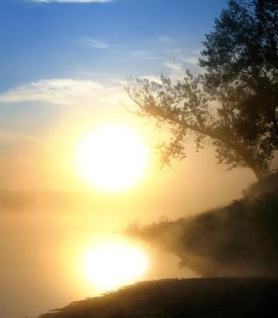 landscape with beautiful fog sunrise on river photo