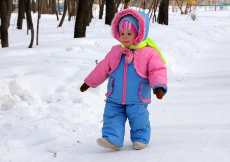 baby girl in winter park  Stock Photo