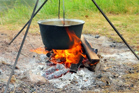 outdoor pursuit: camping - kettle over campfire