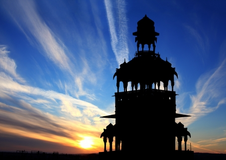 cenotaph silhouette against beautiful sunset in India photo