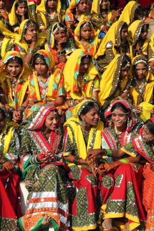 ethnic attire: PUSHKAR, INDIA - NOVEMBER 21: Group of Indian girls in colorful ethnic attire attends at Pushkar camel fair on November 21, 2012 in Pushkar, Rajasthan, India.  Editorial