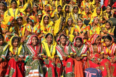 PUSHKAR, INDIA - NOVEMBER 21: Group of Indian girls in colorful ethnic attire attends at Pushkar camel fair on November 21, 2012 in Pushkar, Rajasthan, India.