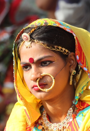 PUSHKAR, INDIA - NOVEMBER 21: Portrait of Indian girl in colorful ethnic attire at Pushkar camel fair on November 21, 2012 in Pushkar, Rajasthan, India.