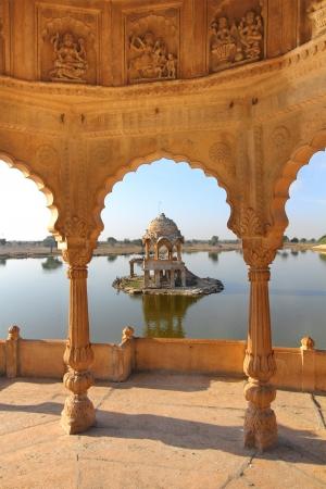 jainism: old jain cenotaphs on lake in jaisalmer rajasthan india