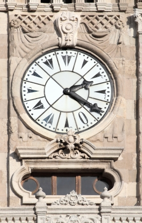 ottoman empire: clock on tower in dolmabahce palace - istanbul turkey Stock Photo