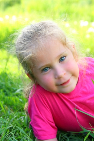 cute smiling little girl outdoor portrait photo