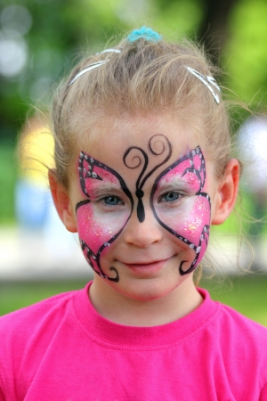 face paint: cute little girl with makeup painted face
