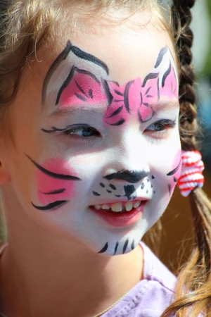 cute little girl with cat makeup painted face 스톡 콘텐츠
