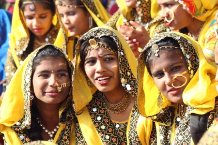 PUSHKAR, INDIA - NOVEMBER 21: Group of Indian girls in colorful ethnic attire attends at Pushkar camel fair on November 21, 2012 in Pushkar, Rajasthan, India.  Stock Photo - 20844545