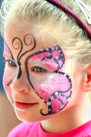 cute little girl with makeup painted face