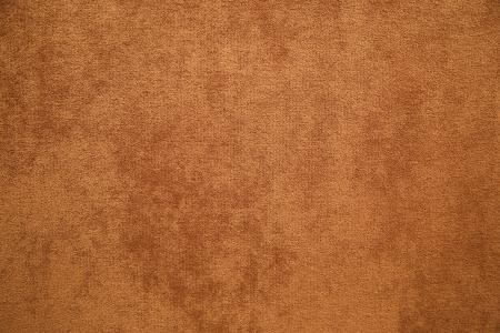 rug texture: brown plush fabric close-up - texture Stock Photo