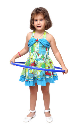 little girl doing exercises with hula hoop photo