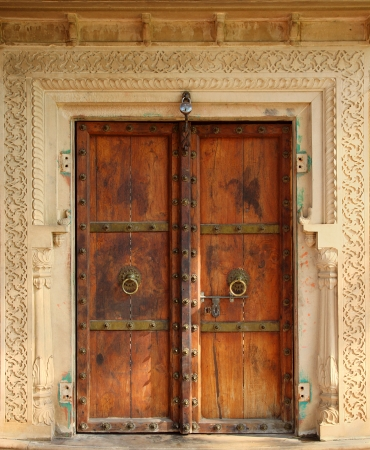 architectural styles: old wooden closed door in india