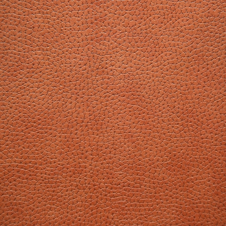 gold textures: brown imitation leather close-up background