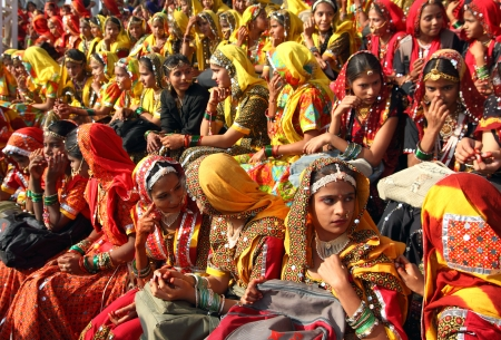 indian fair: PUSHKAR, INDIA - NOVEMBER 21 2012: Group of Indian girls in colorful ethnic attire attends at Pushkar camel fair