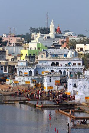 ghat: PUSHKAR, INDIA - NOVEMBER 21, 2012: Ritual bathing in holy lake in Pushkar Editorial