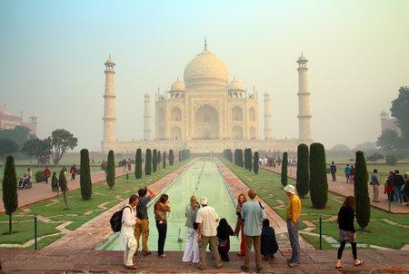agra: AGRA, INDIA - NOVEMBER 17, 2012: tourists in Taj Mahal - famous mausoleum in India  Editorial