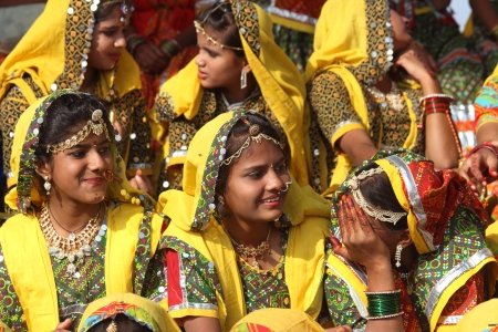 PUSHKAR, INDIA - NOVEMBER 21 2012: Group of Indian girls in colorful ethnic attire attends at Pushkar camel fair