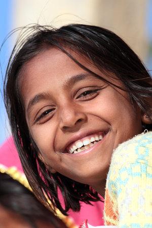 JAISALMER, INDIA - NOVEMBER 28, 2012: Portrait of happy village indian girl 에디토리얼