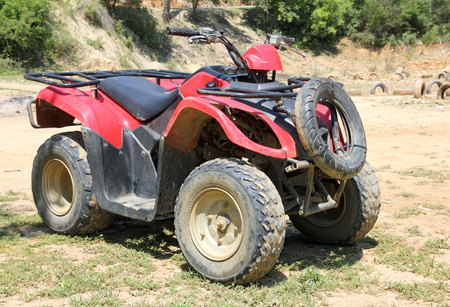 red quad bike atv standing photo